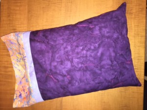 Finished pillowcase with pillow inserted.