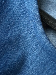 Neckline, bound with bias denim strip.