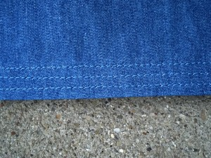 Hem - interfaced with 5/8'  strip of fusible tricot, then folded, pressed, and 3x to-stitched.